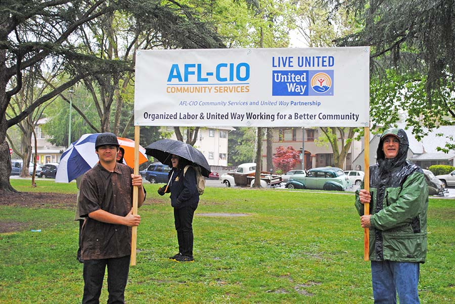 United Way Labor Liaison Greg Larkins (right) braved the weather to represent his organization.
